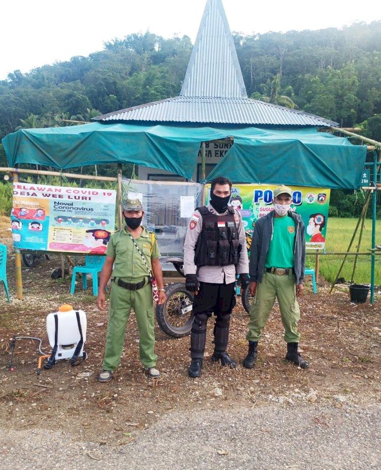 Bhabinkamtibmas Polsek Mamboro Sambang Posko Covid-19