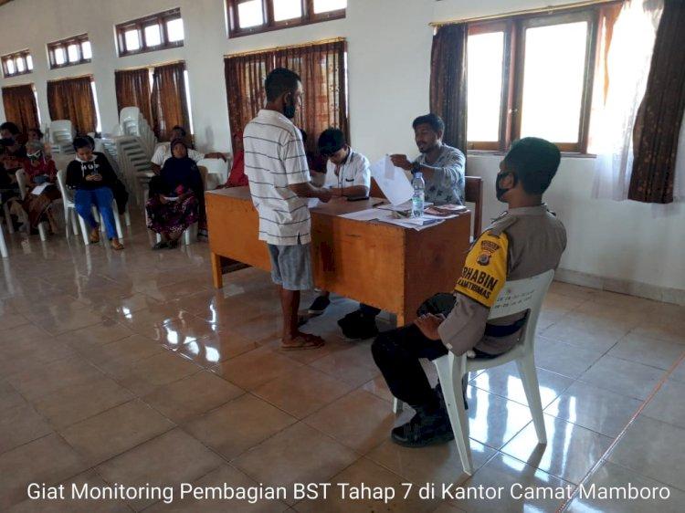 Bhabinkamtibmas Polsek Mamboro Melaksanakan Pengamanan Pembagian Bantuan Langsung Tunai