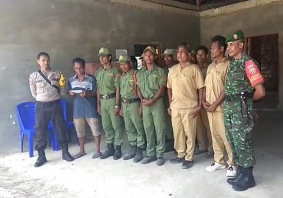 Usai Latihan PBB, Anggota Linmas Desa Welibo Ucapkan HUT Bhayangkara ke 73