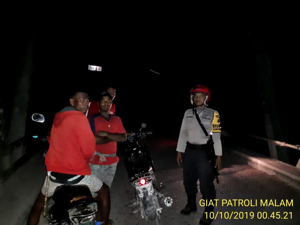 Bhabinkamtibmas Polsek Mamboro Laksanakan Patroli Malam